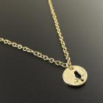 collier medaille oiseau